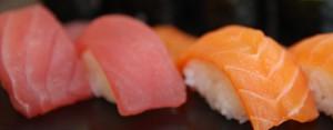 salmon_closeup__nigiri_sushi_hosomaki__uta_sushi_bar-e1360336470373
